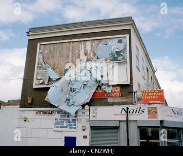 Torn posters on billboard - Stock Photo