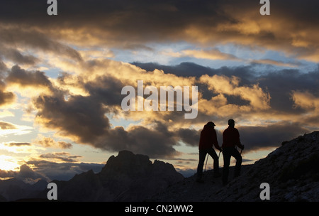 Two hikers in the Dolomites, Italy - Stock Photo