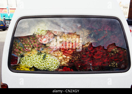 Flowers in car boot - Stock Photo
