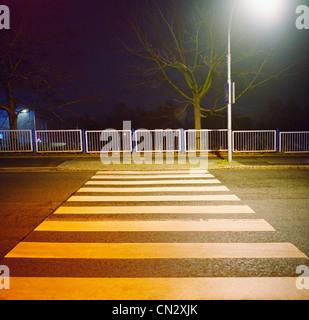 Zebra crossing at night - Stock Photo
