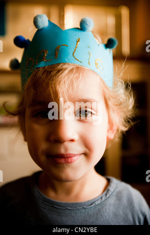 Boy wearing paper crown - Stock Photo
