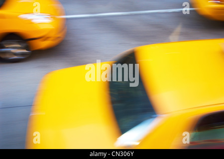 Yellow taxis in motion, New York City, USA - Stock Photo