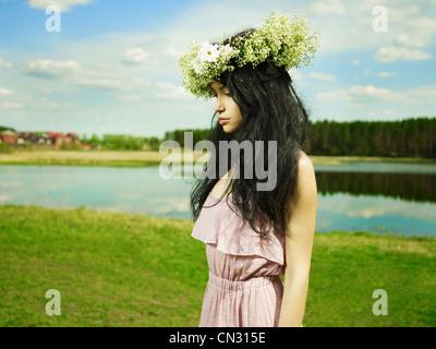 Fashion portrait beautiful girl wearing a wreath of wildflowers - Stock Photo