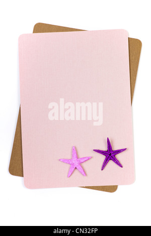 Sheet of paper with starfish in corner - Stock Photo