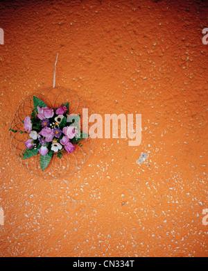 Flower decoration on orange wall - Stock Photo