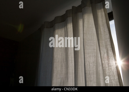 Sunlight coming through a curtain - Stock Photo