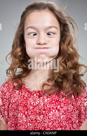 Girl pulling funny face - Stock Photo