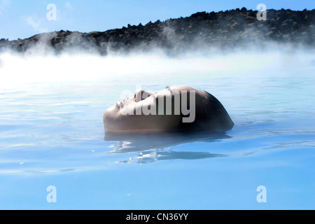 Woman in geothermal pool, Iceland - Stock Photo
