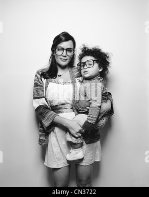 Mother and baby son wearing big glasses - Stock Photo