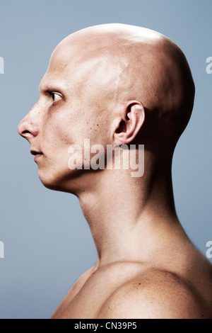Side view of man with shaved head - Stock Photo