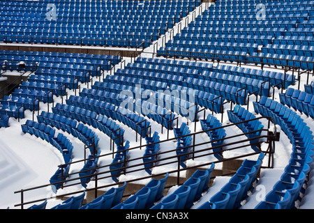 Empty stadium seats in the snow - Stock Photo