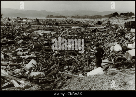 Rikuzentakata, Japan- 20th March 2011: Soldier amongst debris in aftermath of the 2011 Tohoku Earthquake and Tsunami - Stock Photo