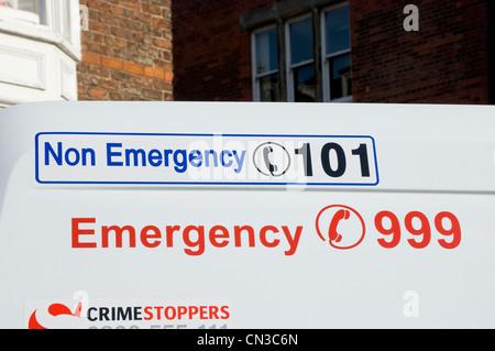 Telephone numbers on police van England UK United Kingdom GB Great Britain - Stock Photo