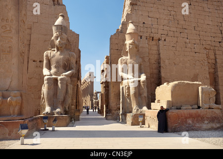 Colossi of Ramses II at the entrance to Luxor Temple, Egypt - Stock Photo