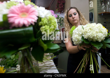 Employees at Boxwoods flower shop in London prepare for one of the busiest weeks of the year. - Stock Photo