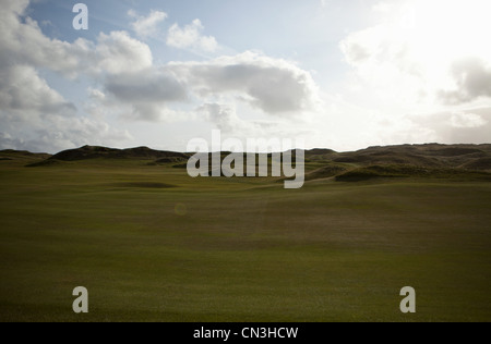 Green, rolling hills on a sunny day - Stock Photo
