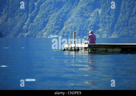 Norway, Sunnmore Region, More og Romsdal County, Geirangerfjord listed as World Heritage by UNESCO, fisherman - Stock Photo