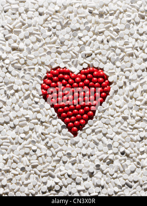 Red pills arranged into heart shape - Stock Photo
