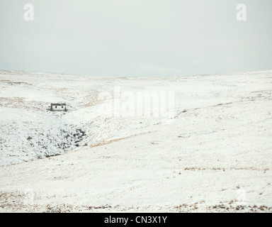 House in the frozen hills - Stock Photo