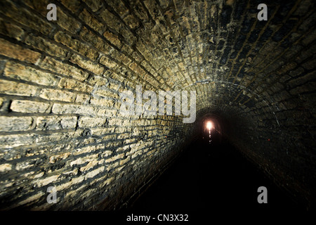 A light shining at the end of a tunnel - Stock Photo