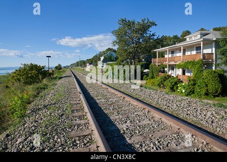 Canada, Quebec province, Charlevoix region, St Irenee, the railway runs along the St Lawrence River - Stock Photo