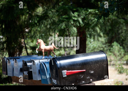 Rural mailboxes with plastic horse figurine - Stock Photo