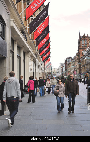 House of Fraser and sale flags adorn the store front in a busy Buchanan Street, Glasgow - Stock Photo