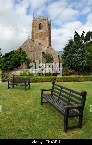 Garden in front of the church of St George in Dunster, Somerset, UK. - Stock Photo