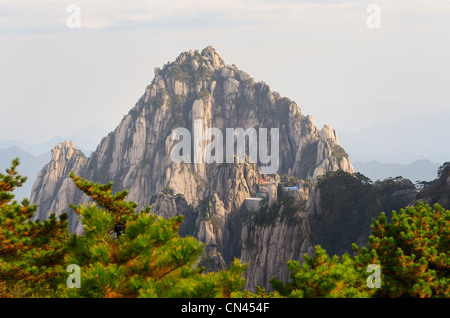 Jade Screen Tower with hotel and Heavenly City Peak from Brightness Top on Huangshan Yellow Mountain China - Stock Photo