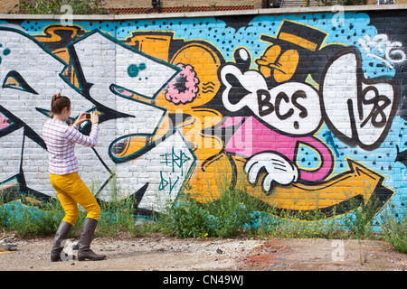 United Kingdom, London, Hackney, Shoreditch, graffiti photographed by a young woman - Stock Photo