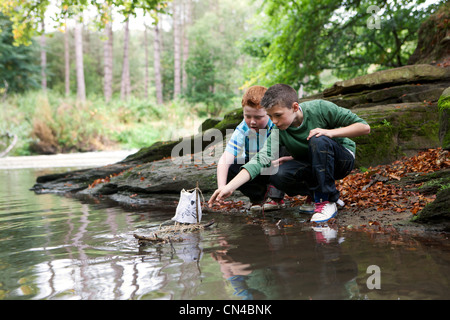 Boys playing with a pirate ship - Stock Photo