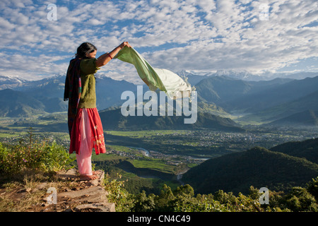 Nepalese woman holding scarf on cliff edge - Stock Photo