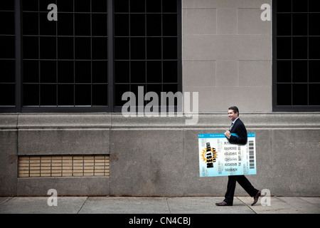Businessman carrying oversized lottery ticket - Stock Photo