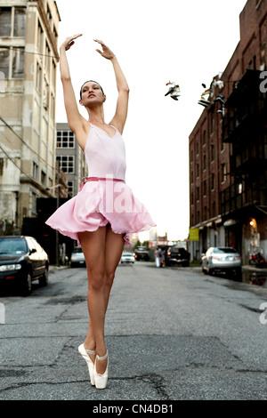 Ballerina on an urban street - Stock Photo