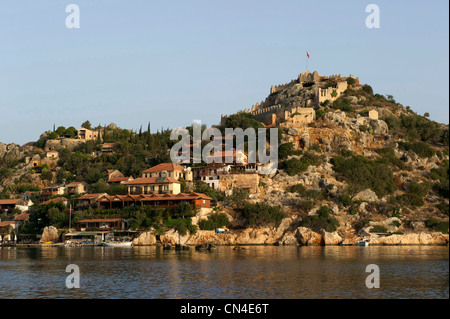 Turkey, Mediterranean Region, Turquoise Coast, Lycia, Kekova Bay, near Kas, Kalekoy, view of the village and fortress - Stock Photo
