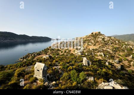 Turkey, Mediterranean Region, Turquoise Coast, Lycia, Kekova Bay, near Kas, Kalekoy, Lycian sarcophargus and fortress - Stock Photo