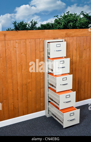 Filing cabinets in garden fence - Stock Photo