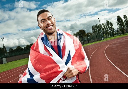 Sprinter wrapped in Union flag on sportstrack - Stock Photo