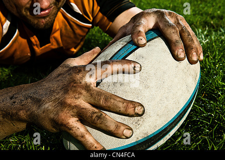 Rugby player scoring on pitch - Stock Photo