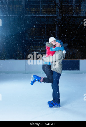 Couple embracing on an ice rink - Stock Photo