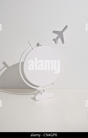 Plane taking off from globe - Stock Photo