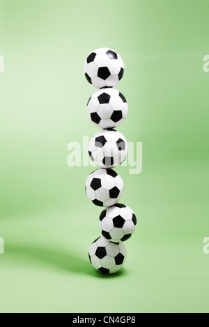 Six footballs stacked on top of each other
