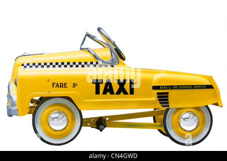 Kid's size small version of a vintage Yellow New York Taxi Cab. A push bike pedal car. Cut out isolated on white - Stock Photo
