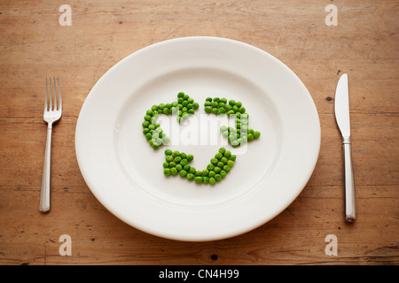 Peas in shape of recycling symbol - Stock Photo