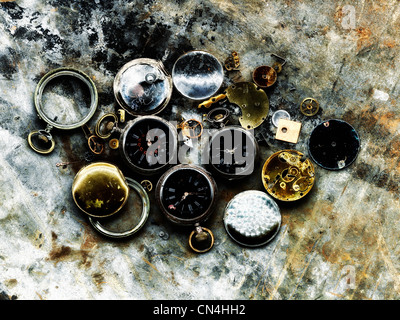 Broken pocket watches - Stock Photo