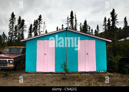 Shed painted in pink and blue - Stock Photo