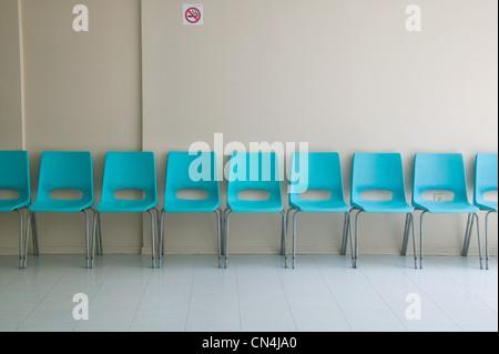 Row of plastic chairs - Stock Photo