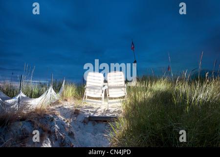Illuminated beach chairs on sand dune, Baltic Sea, Germany - Stock Photo