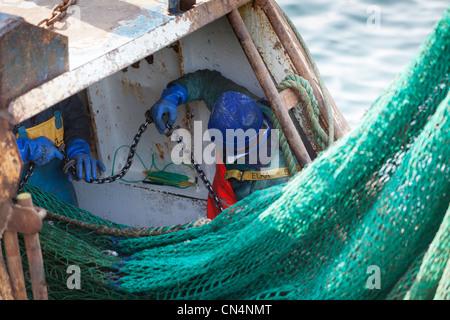 Maintenance and repair Fishing nets. Deep sea Fishing trawler Fraserburgh Scotland UK - Stock Photo