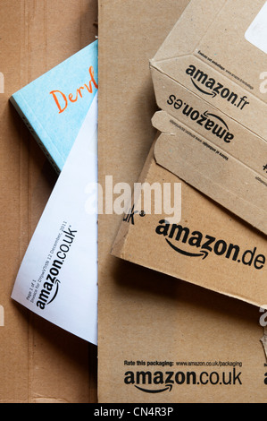 Uk cardboard package parcel from amazon isolated on a white stock amazon book packaging showing web site addresses from different countries stock photo reheart Gallery